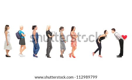 Females waiting in line to kiss a guy isolated on white background