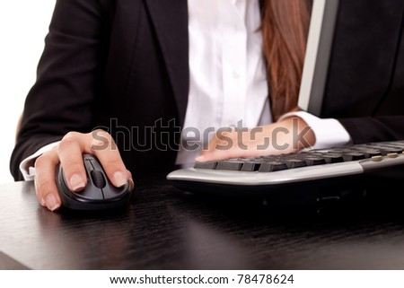 females working with computer mouse and keyboard - stock photo