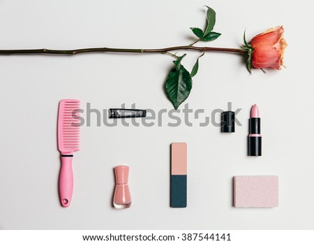 Feminine accesories in pink tones over white background - stock photo