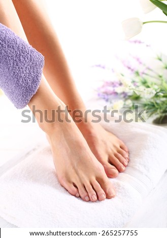 Feminine beauty treatments legs and feet. Foot care treatment and nail, the woman at the beautician for pedicure. - stock photo