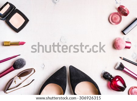 Feminine cosmetic background. Overhead of essentials of a modern woman. Cosmetic objects frame - stock photo