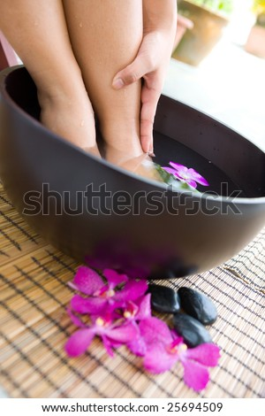 Feminine feet in foot spa - stock photo