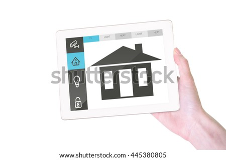 Feminine hand holding tablet against screen with information about home