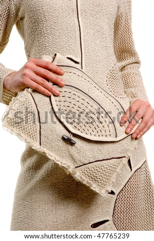 Feminine hands keeps knitted hand-bag