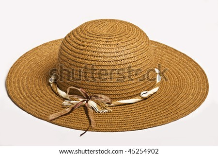 Feminine raffia hat in ocher with a bow on white background. - stock photo