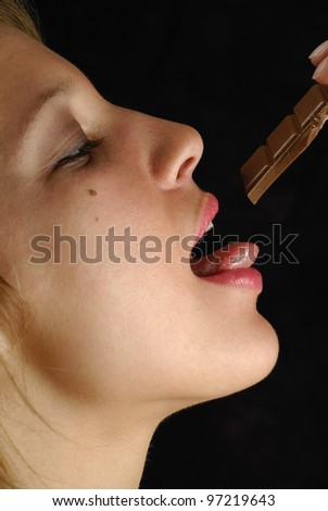 femme, gourmandise et chocolat - stock photo