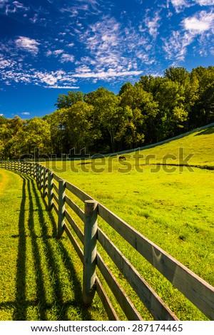Fence and beautiful farm field in York County, Pennsylvania. - stock photo