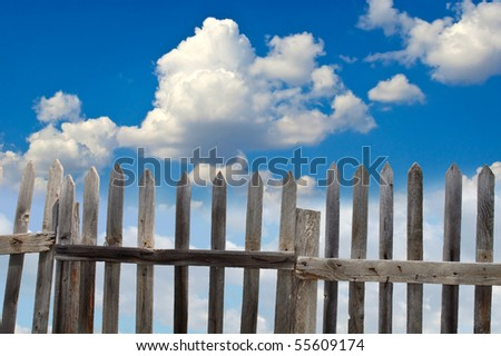 fence and blue sky - stock photo