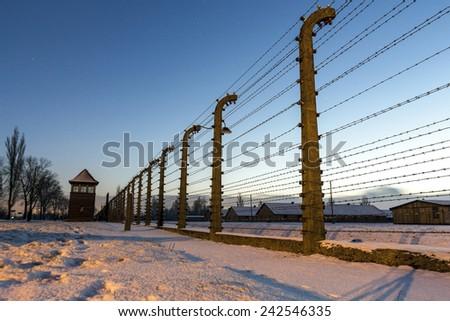 Fence around nazi concentration camp of Auschwitz Birkenau, Poland - stock photo