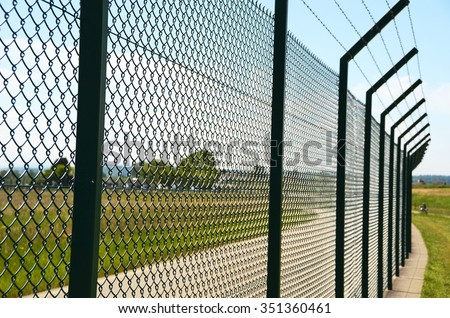 Fence around restricted area - stock photo