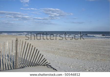 Fence at beach - stock photo