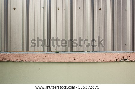 Fence below is a cement on a zinc - stock photo