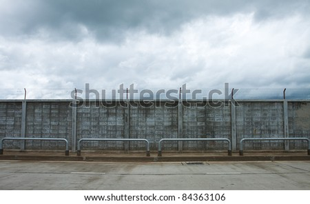 Fence beside of road. - stock photo