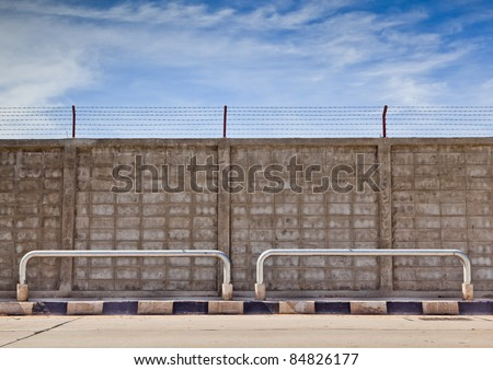 Fence beside of road with blue sky background - stock photo