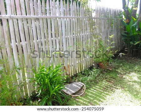 Fence in a tropical garden in Asia. - stock photo