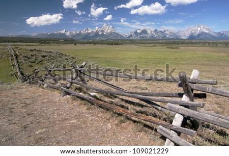 Fence line along the Grand Tetons - stock photo