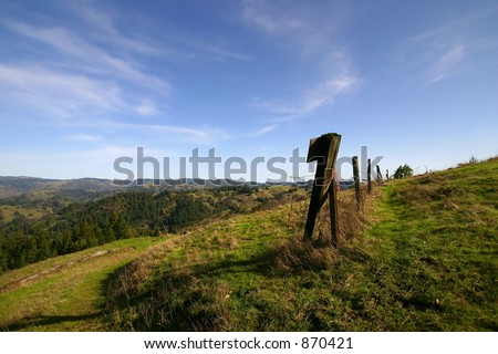 Fence line at one of the highest points of elevation in Sonoma County California. - stock photo