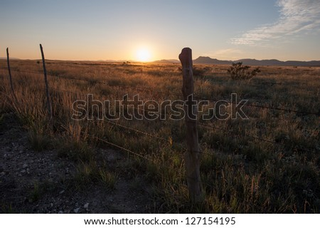 Fence Line in Big Bend - stock photo