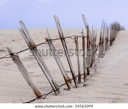Fence Line in Ocean City, MD - stock photo