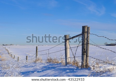 Fence line on Canadian Prairie - stock photo