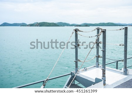 Fence of ship in the sea on cloudy sky background