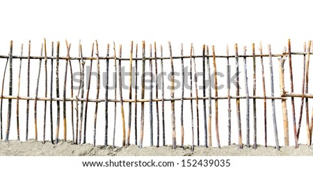 fence of twigs isolated on white background - stock photo