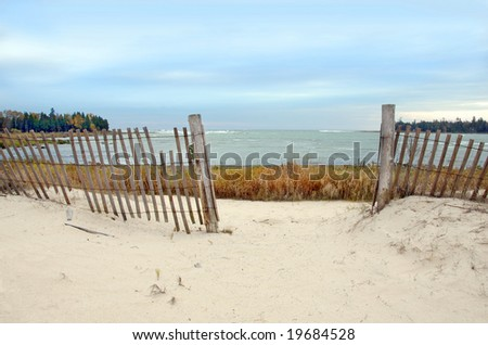 Fence on a beach in Door County, Wisconsin. Lake Michigan - stock photo