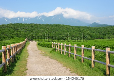 Fence, pathway and famous mountain, north of Japan - stock photo