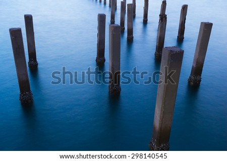 Fence protect sandbank from sea wave, nature protection - stock photo