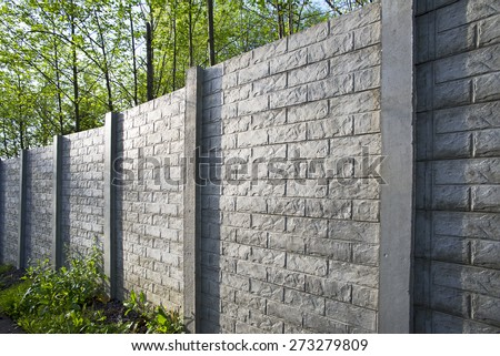 Fence, wall - concrete wall in a park - stock photo