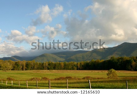 Fenced field in Cades Cove in Great Smoky Mountains  National Park - stock photo