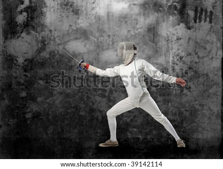 fencing player on grunge background - stock photo