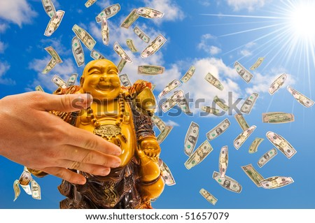 feng shui. buddha against a blue sky with  falling  dollars. - stock photo