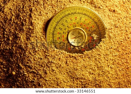 Feng shui compass in Sand - stock photo