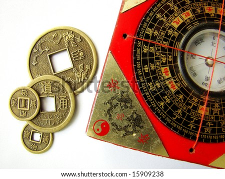 Feng shui compass (Luopan) and chinese coins. - stock photo