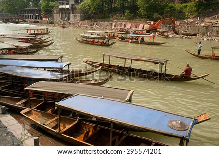 FENGHUANG,CHINA - JUNE 9 :Tourist boats in river of Fenghuang on June 9, 2015 in Fenghuang,Hunan,China.This ancient town was added to the UNESCO World Heritage Tentative List in the Cultural category.