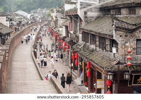 FENGHUANG, CHINA - JUNE 9 : View the inside of Fenghuang old city on June 9, 2015 in Fenghuang, China.This ancient town was added to the UNESCO World Heritage Tentative List in the Cultural category. - stock photo