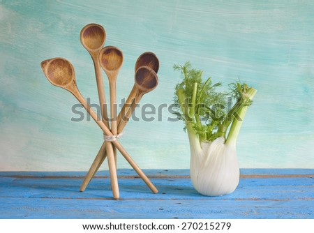 fennel and wooden spoons, free copy space - stock photo