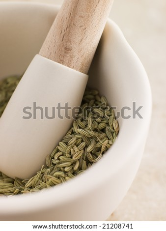 Fennel Seeds In A Pestle And Mortar