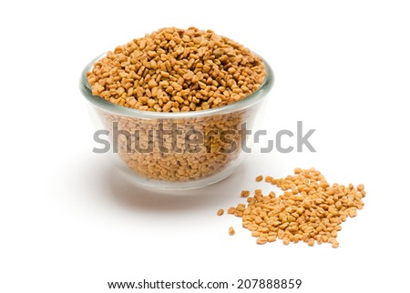 Fenugreek seeds in glass bowl isolated on white background