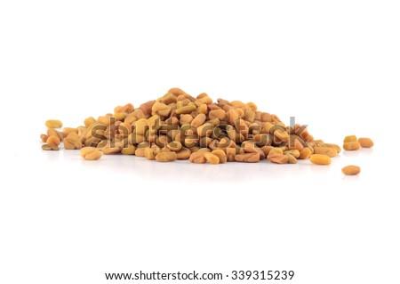 Fenugreek seeds isolated on white background  - stock photo