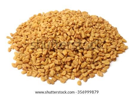 Fenugreek seeds on white background - stock photo