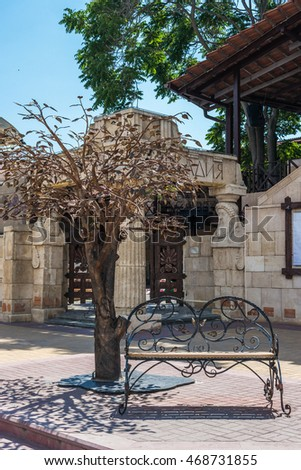 FEODOSIA, RUSSIA, - JUNE 15, 2015: Bronze bench and a tree in the city center.