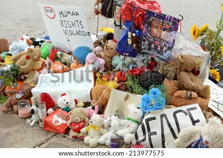 FERGUSON, MO/USA - AUGUST 30, 2014: A makeshift memorial near where black teenager Michael Brown was shot to death by police in Ferguson, Missouri. - stock photo