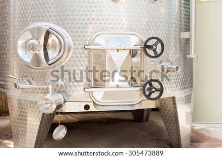 Fermentation tank closeup for wine. - stock photo