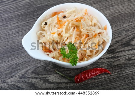 Fermented cabbage sauerkraut with carrot and pepper - stock photo