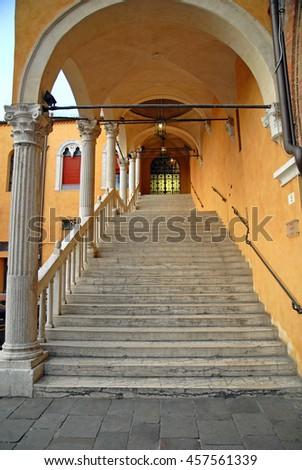 Ferrara, antique majestic staircase to access the municipal building. - stock photo