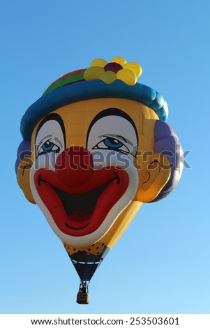 Ferrara, Italia - September 14, 2014: The photo was made at the Ballons Festival at Ferrara on september 14, 2014.A hot air balloon shaped like a clown gets up in the sky - stock photo
