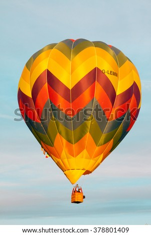 "Ferrara, Italy - September 19, 2015: Hot-air balloons during flight at dawn at ""Ferrara Balloons festival 2015"""