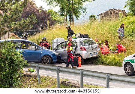 Ferrera di Varese, Varese, Italy - June 16, 2016: Road accident and rescue workers tending to car accident victim. - stock photo